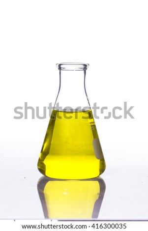 Test-tube with  liquid isolated on white - stock photo
