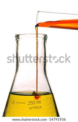Test tube with red liquid pouring into a laboratory conical Erlenmeyer flask with yellow chemical solution and causing a reaction for an experiment in a science research lab - stock photo