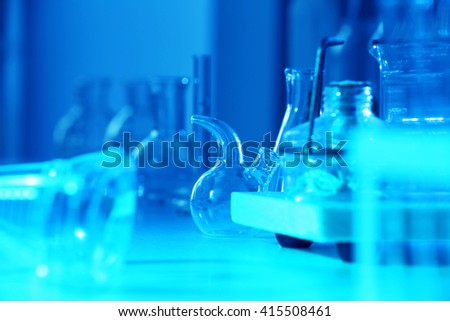 Test tubes and flasks on laboratory table closeup - stock photo