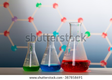 Test-tubes and green leaf tested in petri dish on, background molecules. - stock photo