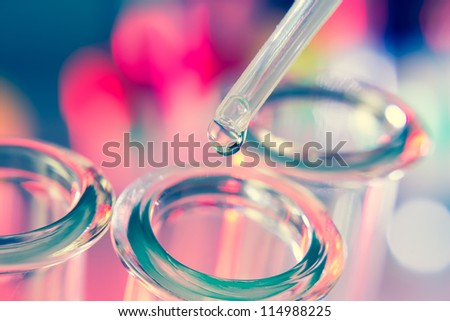 Test tubes closeup on blue background. - stock photo