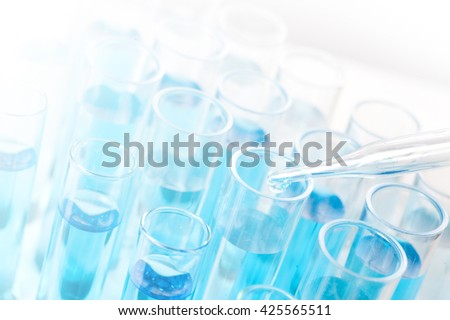 Test tubes closeup on blue background..medical glassware - stock photo