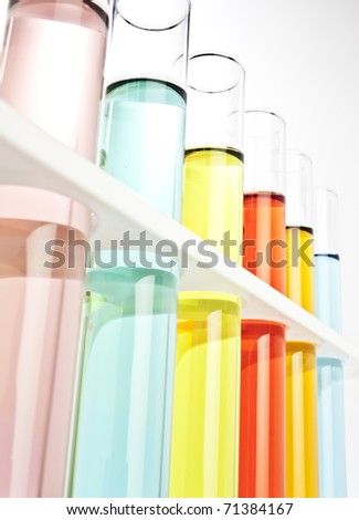 Test tubes filled with colored fluid - stock photo