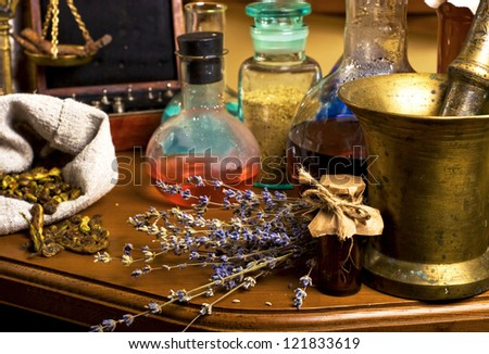 Test tubes herbs, chemical equipment for laboratory researches - stock photo