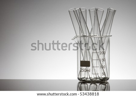 test tubes in a beaker with a white background - stock photo