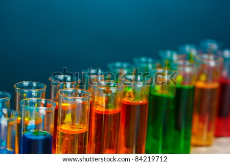 test tubes in a laboratory on a blue background - stock photo