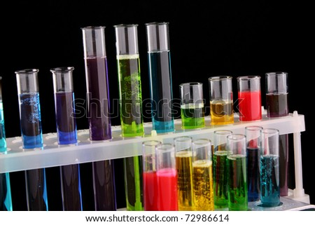 Test tubes on black background