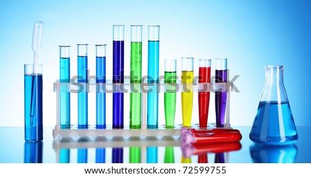 Test tubes on blue background - stock photo