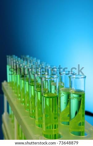 Test-tubes on blue background - stock photo