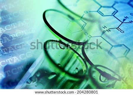 Test tubes over blue background - stock photo