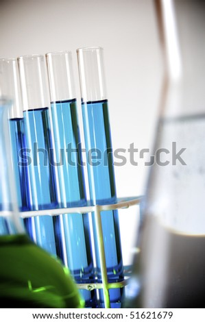 test tubes with blue liquid in a laboratory - stock photo