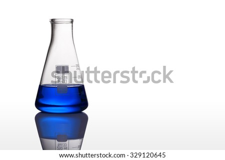 test tubes with blue liquid on white background - stock photo