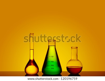 test tubes with colored liquid, a still life, a place for text - stock photo