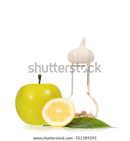 Test tubes with colorful pills slice lemon and garlic, isolated on white background - stock photo
