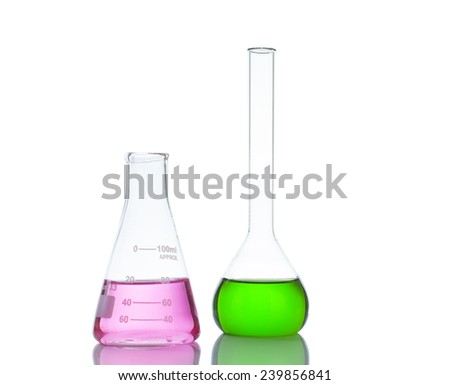 Test-tubes with green and pink liquid isolated on white - stock photo