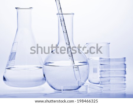 Test-tubes with reflections on a white and blue background. Laboratory glassware. - stock photo
