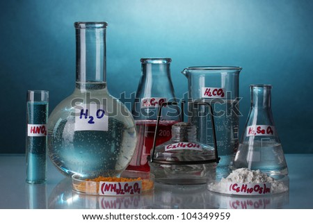 Test-tubes with various acids and chemicals  on bright background - stock photo