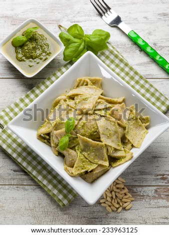 testaroli with pesto sauce, traditional italian recipe