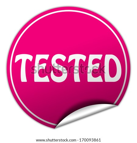 tested pink round sticker on white background - stock photo