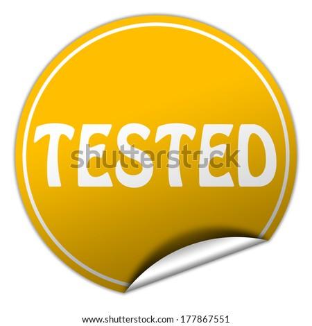 tested round yellow sticker on white background - stock photo