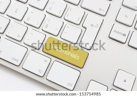 Testimonial key on a white keyboard - stock photo