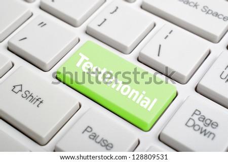Testimonial on keyboard - stock photo