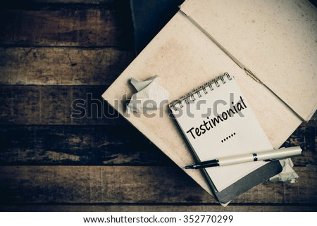 Testimonial word on pages sketch book on wood table vertical  - stock photo