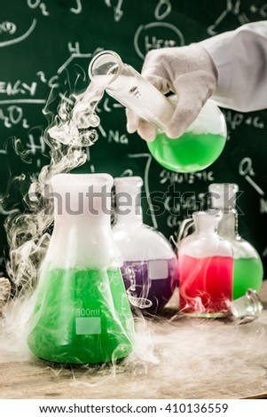 Testing new chemical reactions in university lab - stock photo