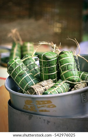 Tet cake (Banh Tet) is a cake made primarily from glutinous rice, which is rolled in a banana leaf into a thick, log-like cylindrical shape, with a mung bean and pork filling, then boiled.