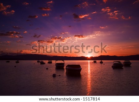 Tethered boats in Lake Tahoe - stock photo