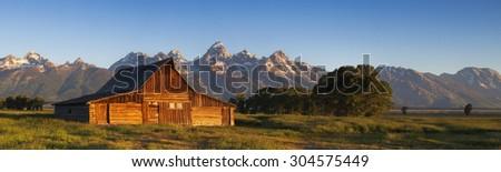 Teton panorama of a Mormon Row barn - stock photo