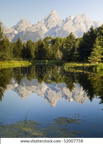 Tetons Reflected at Schwabacher's Landing, Grand Teton National Park, Wyoming - stock photo