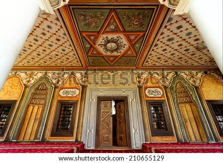 TETOVO-JUNE 12, 2014: Decorated Mosque in Tetovo (Macedonia) was built in 1438 by two sisters from Tetovo and it was called Aladza, which means colourful. - stock photo