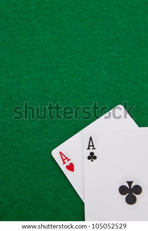 Texas holdem pocket aces on casino table with copy space - stock photo