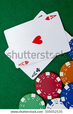 Texas holdem pocket aces on casino table with copy space and chips - stock photo