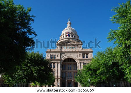 Texas state capitol in Austin nested by trees - stock photo