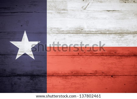 Texas State Flag on barn wood, with faded colors - stock photo