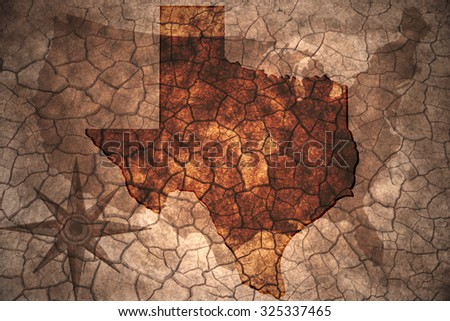 Texas state map on vintage usa map, crack paper background - stock photo