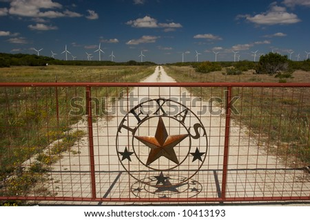 TEXAS WIND FARMS with rusted gate - stock photo