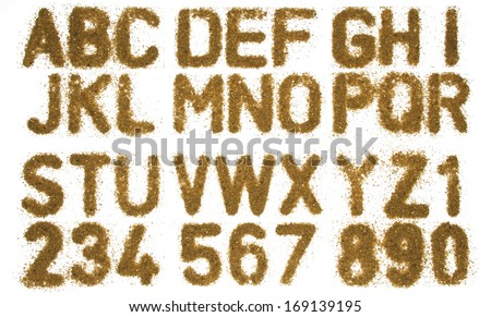 text a b c made form sand isolated - stock photo