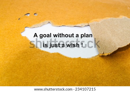 Text a goal without a plan is just a wish! on envelope  - stock photo