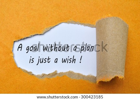Text a goal without a plan is just a wish! on paper and wood. - stock photo