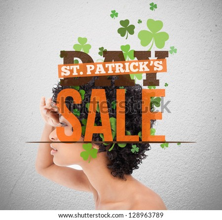 Text advertisement for st patricks day sale with girl looking into distance - stock photo