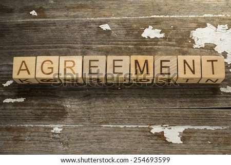 text: Agreement on a wooden background - stock photo
