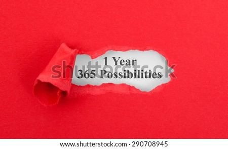 Text appearing behind torn red envelop - 1 Year, 365 possibilities - stock photo