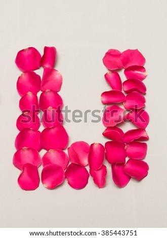 text arranged by champa flowers, Black background isolated, (U)