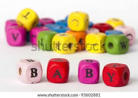 Text baby on colorful wooden cubes - stock photo
