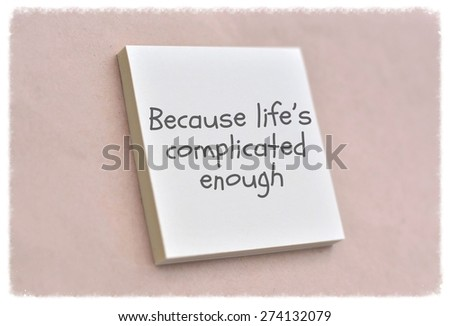 Text because life is complicated enough on the short note texture background - stock photo