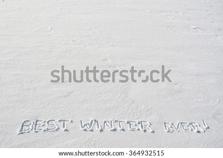 Text BEST WINTER  EVER hand written on snow background. Horizontal postcard template. Space for copy, lettering. - stock photo