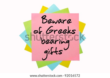 "text ""Beware of Greeks bearing gifts"" written by hand font on bunch of colored sticky notes"